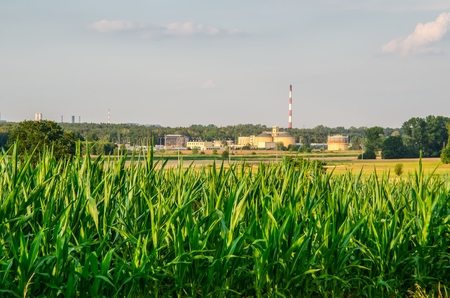 Sunny summer landscape. Waste water treatment plant in rural scenery. Stock Photo