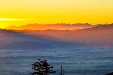 Beautiful morning autumnal mountain landscape. Impressive sunrise over the peaks of the mountains.