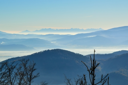 Beautiful mountain landscape. Fog in the valleys in the morning.