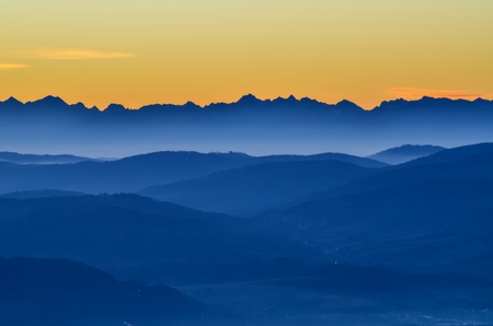 Beautiful morning autumnal mountain landscape. Interesting light over the mountain tops just before dawn. 版權商用圖片