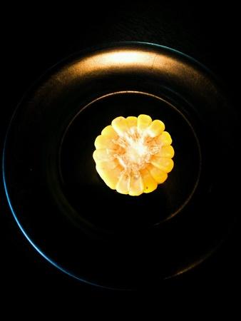 dark: Corn on dark dish