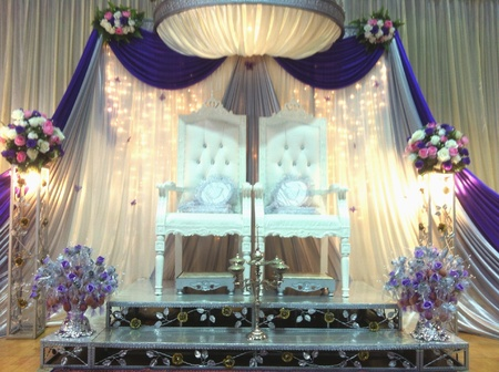 shiny: White wedding throne on shiny curtain