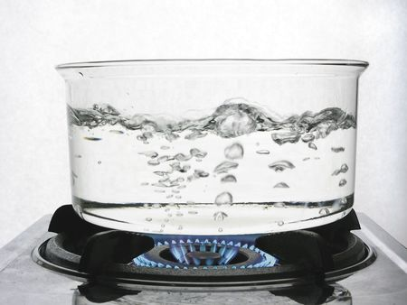 boiling pot: Water boiling in a clear pot over gas