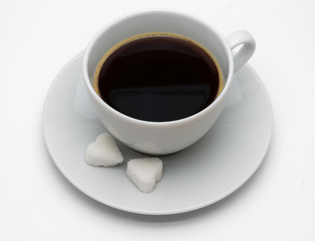 Black coffee with sugar on white background photo