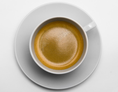 Black coffee with foam on white background photo