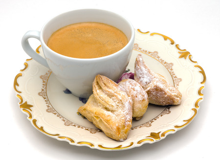 Bow puff pastry with coffee photo