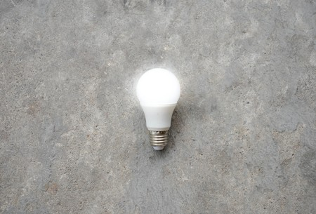 hands of light: LED Bulb with lighting - Save lighting technology - Zoom out Stock Photo