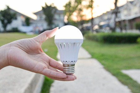 led bulb: LED Bulb - saving technology in our hand Stock Photo