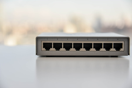 network switch: 8 ports of small network switch Stock Photo