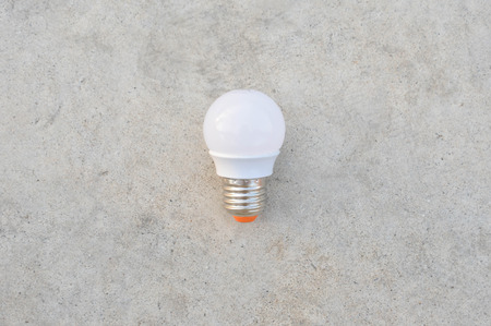 tungsten: LED Bulb on the white concrete Stock Photo