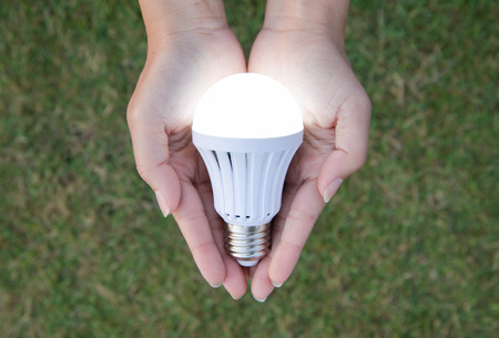 led bulb: LED Bulb with lighting - saving technology in our hand Stock Photo