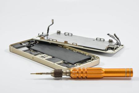 Broken of mobile phone and repair tool on white screen