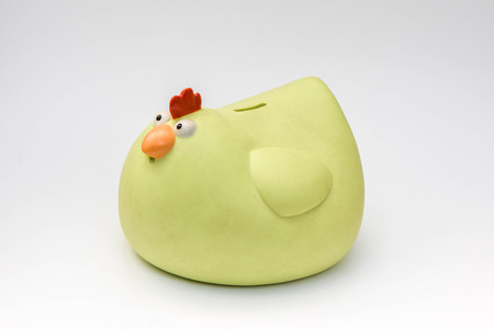 Yellow chicken piggy bank on white background Banco de Imagens