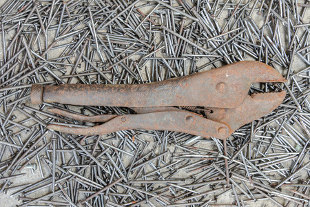 locking: Old Locking Pliers on the nail