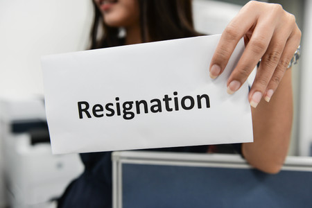 resignation: Business woman submitted the Letter of Resignation