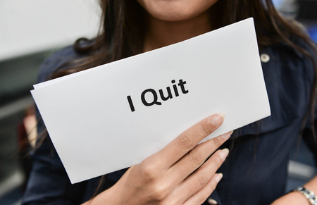 quitting: I Quit - Business woman is showing the document for resignation for quit the job