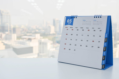 Calendar of May on the white table with city view background