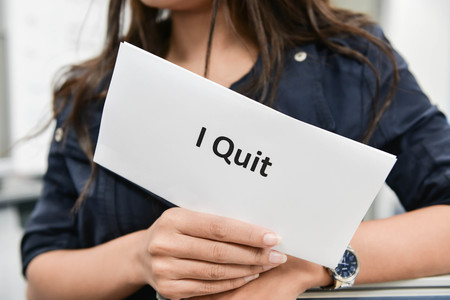 resignation: I Quit - Business woman is showing the document for resignation for quit the job
