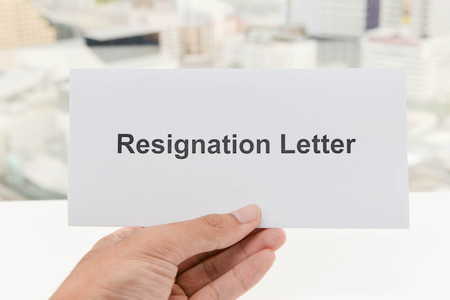 resignation: Human hand is holding the Resignation letter