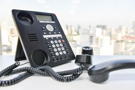 teleconference: Phone handset line spiral - Conference call concept
