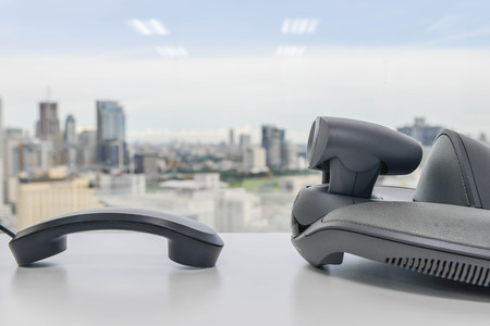 mobile voip: Video Conference Device and Phone handset on the white table