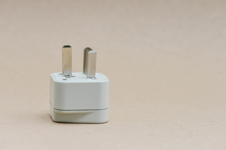 compatible: Electric travel plug on the brown background