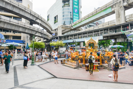 phrom: Thailand Bangkok Aug14,2016 - The nationalities are praying to four face Buddha at Ratchaprasong Intersection Editorial