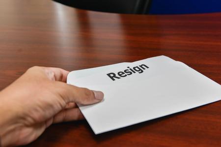 Hand hold resignation letter for submit to resign Lizenzfreie Bilder