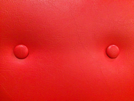 Texture of red leather sofa with studs Stock Photo