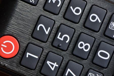 Macro of remote button number and power Lizenzfreie Bilder