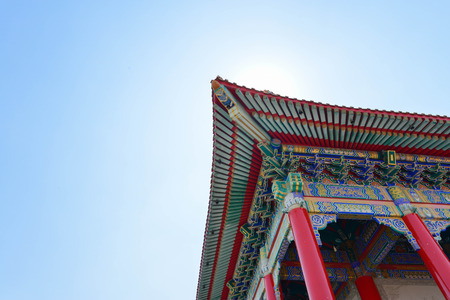 The Chinese temple roof under blue sky
