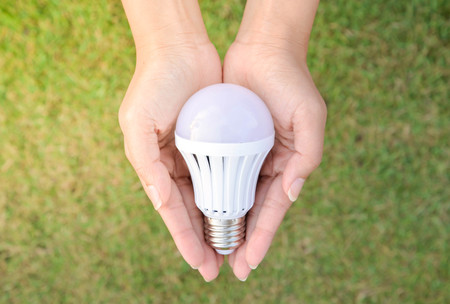 LED Bulb - saving technology in our hand Stock Photo