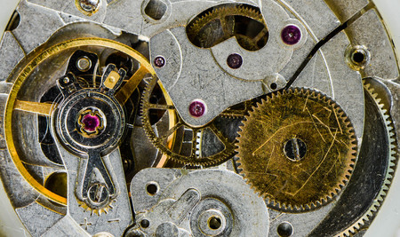 Macro of the pendulum and gears of the old watch
