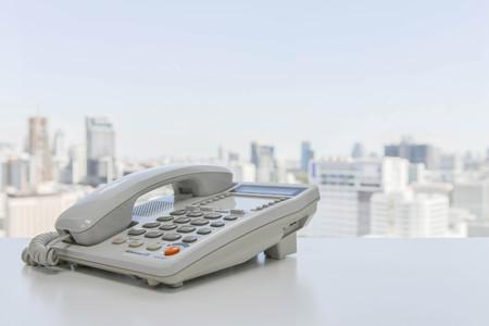 White office phone on the white table Banco de Imagens