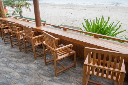 table and wooden seats at the beach