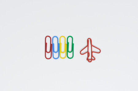 Business concept of difference employee for group of colorful paperclip and another difference red plane paperclip