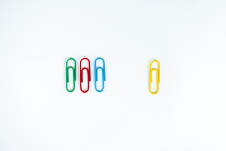 Business concept of difference employee for group of colorful paperclip and another difference yellow paperclip Stock Photo