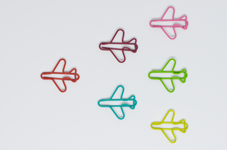 Colorful plane paperclip point to same direction shaped like arrow for business concept of teamwork and team leadership 写真素材