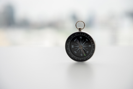 Compass on the white table Standard-Bild - 106658907