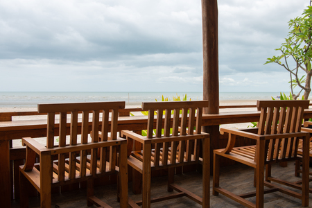 table and wooden seats at the beach Standard-Bild - 106658910