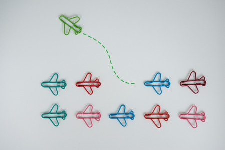 Business concept for group of plan paperclip with another one green plane paperclip is point to another direction as a team individual leadership - Flay lay Standard-Bild - 106658950