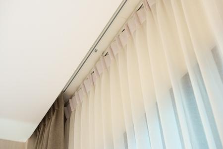Curtain rail with white and brown curtain Standard-Bild - 106658948