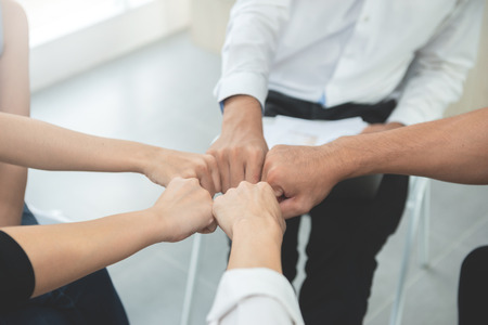 Asian business people group join the hand for collaboration and support, team work concept Standard-Bild - 106658990