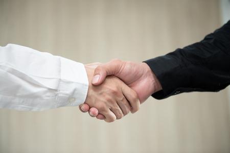 Business man hand shake for business deals Standard-Bild - 106658988