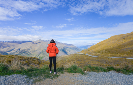 Asian woman tourist stand on the hill at Lindis  in New Zealand Standard-Bild - 106658996