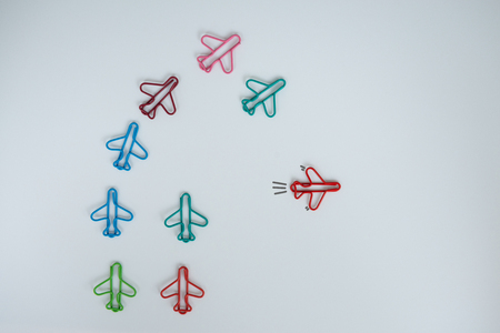 Business concept for group of stacked paperclip with another one red plane paperclip is point to another direction as a team leadership Standard-Bild - 106658994