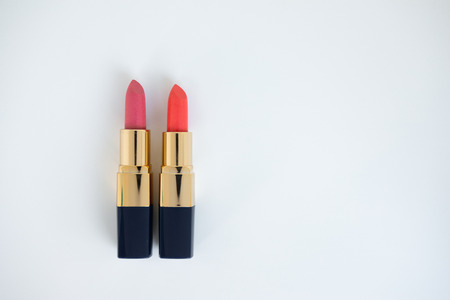 Flat lay minimal concept of creative female cosmetic for pink and red lipstick on the white background with copy space Standard-Bild - 106659002