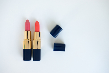 Flat lay minimal concept of creative female cosmetic for pink and close lipstick on the white background with copy space Standard-Bild - 106659030