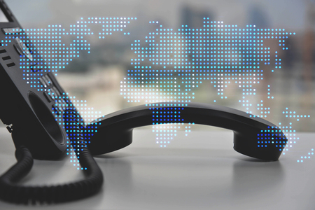 IP Phone double exposure of blue LED world map for communication concept Standard-Bild