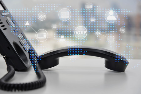 IP Phone double exposure with blue LED world map and business icon of VOIP human and  for communication concept Standard-Bild - 118981075